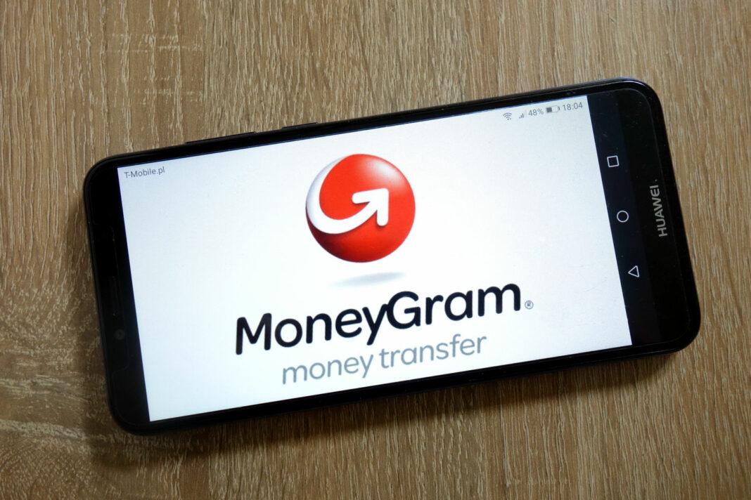 MoneyGram International Inc. logo displayed on smartphone