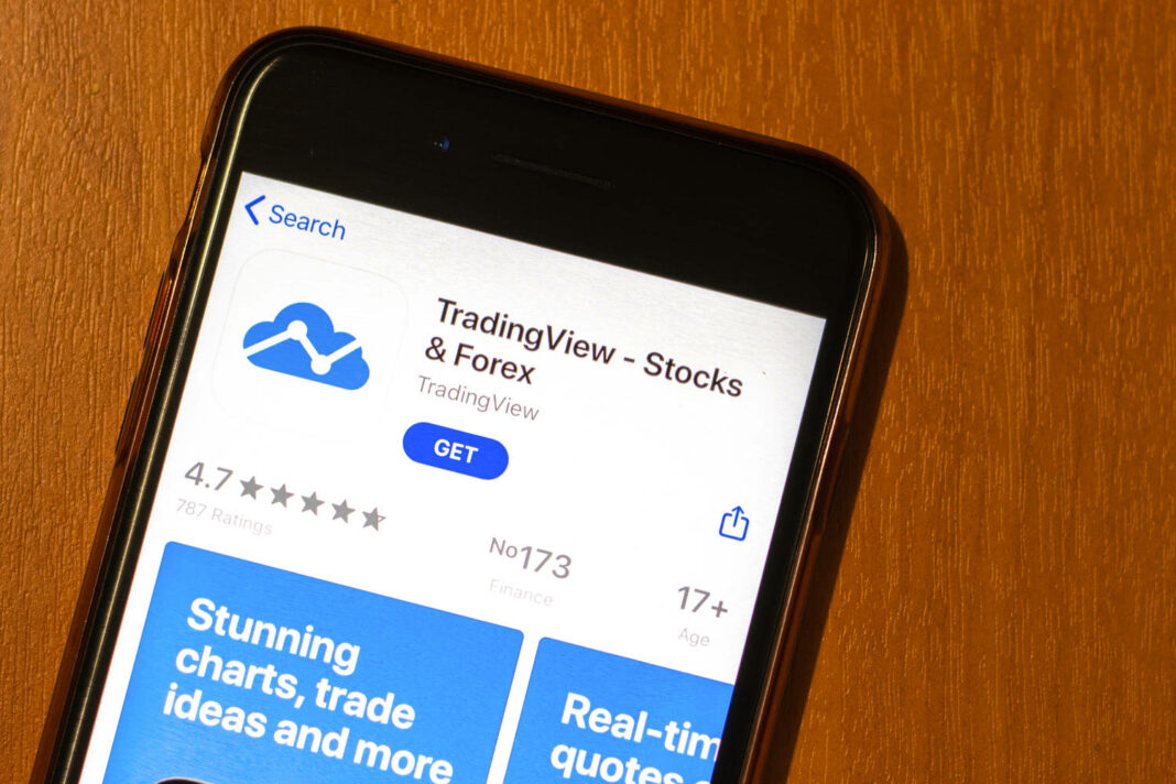 Phone screen with TradingView icon on app store top view